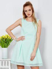 Sukienka miętowa z siatkowymi wstawkami