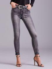 Szare spodnie jeansowe z suwakami