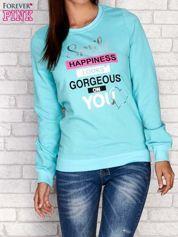 Turkusowa bluza z napisem SMILE HAPPINESS LOOKS GORGEOUS ON YOU
