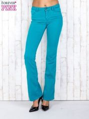 Zielone materiałowe spodnie dzwony