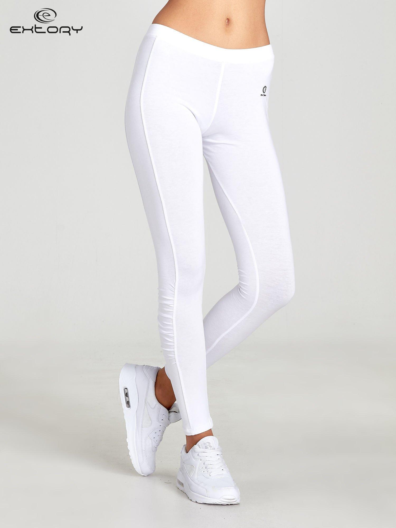 Białe legginsy sportowe z drapowaniem                                  zdj.                                  1