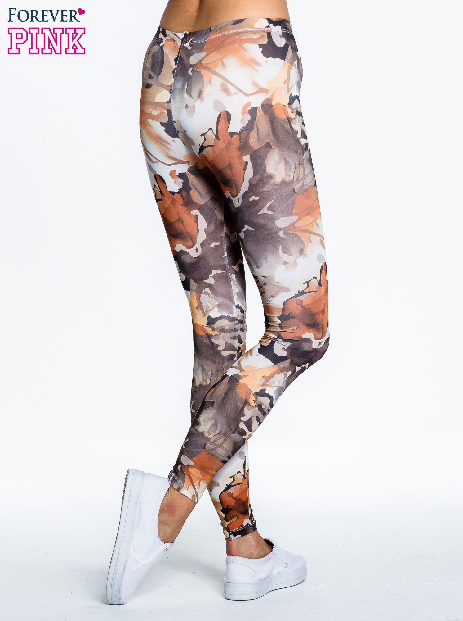Brązowe legginsy w wielobarwne wzory                                  zdj.                                  4