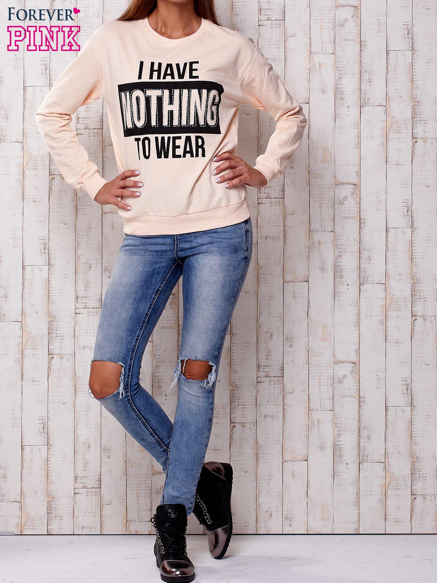 Brzoskwiniowa bluza z napisem I HAVE NOTHING TO WEAR                                  zdj.                                  4