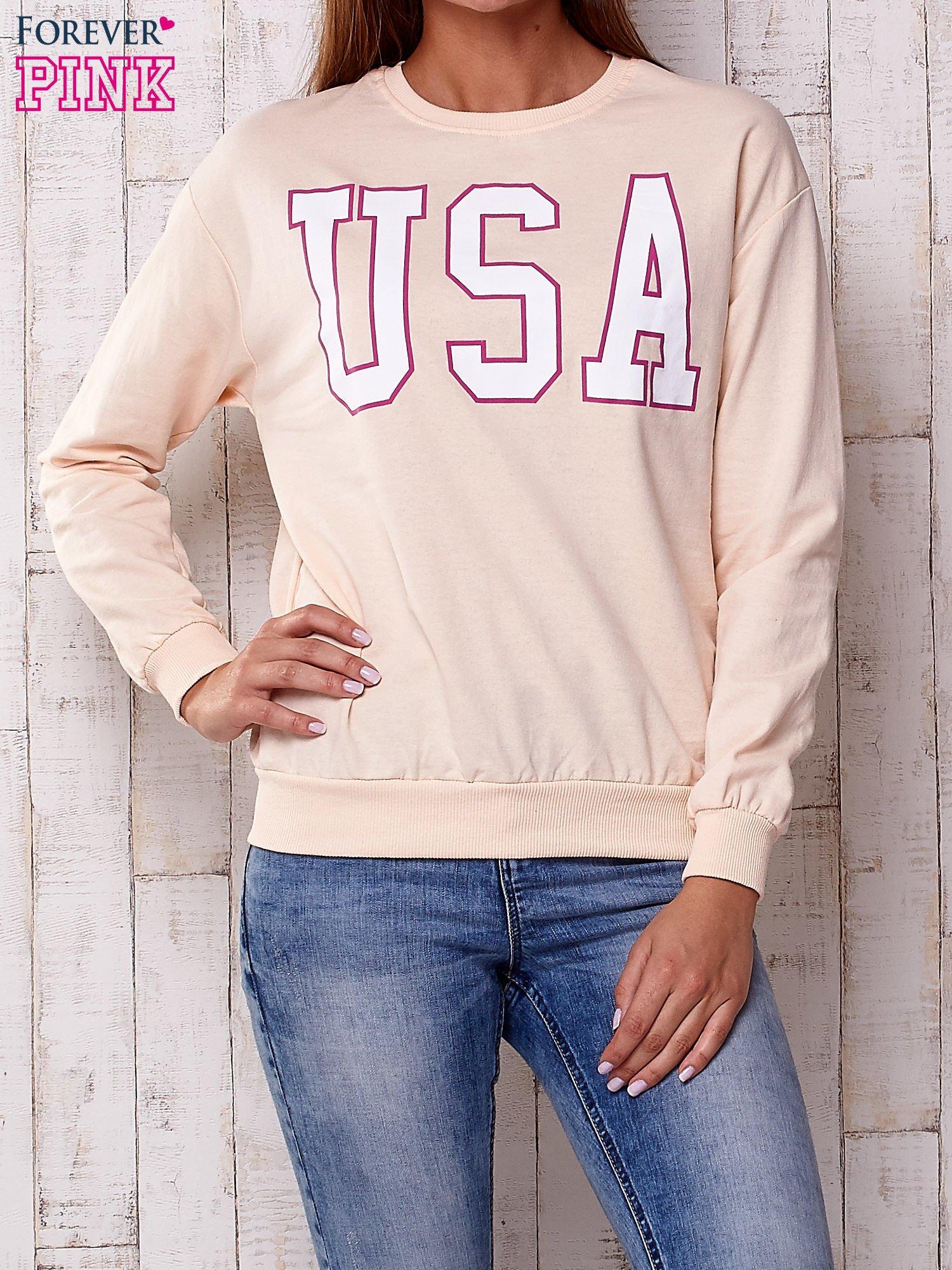 Brzoskwiniowa bluza z napisem USA                                  zdj.                                  1