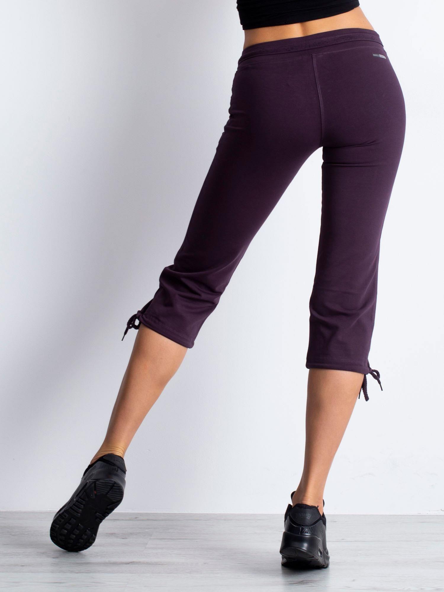 Ciemnofioletowe spodnie dresowe capri z kieszeniami na suwak                                  zdj.                                  5