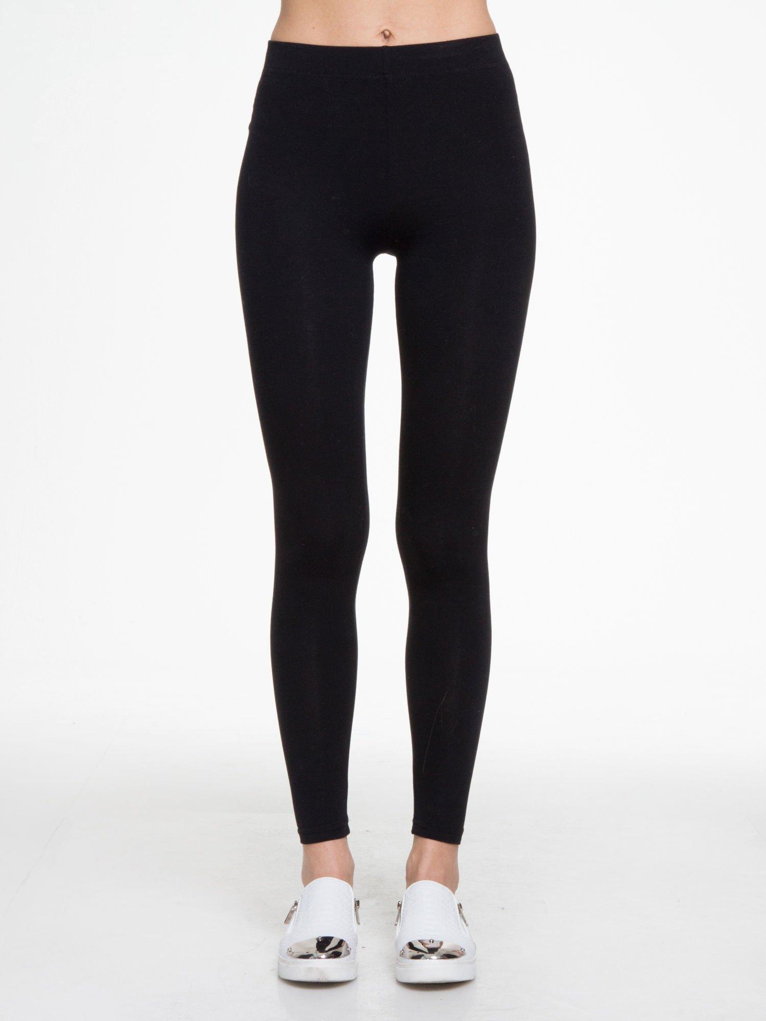 Czarne gładkie elastyczne legginsy                                  zdj.                                  1