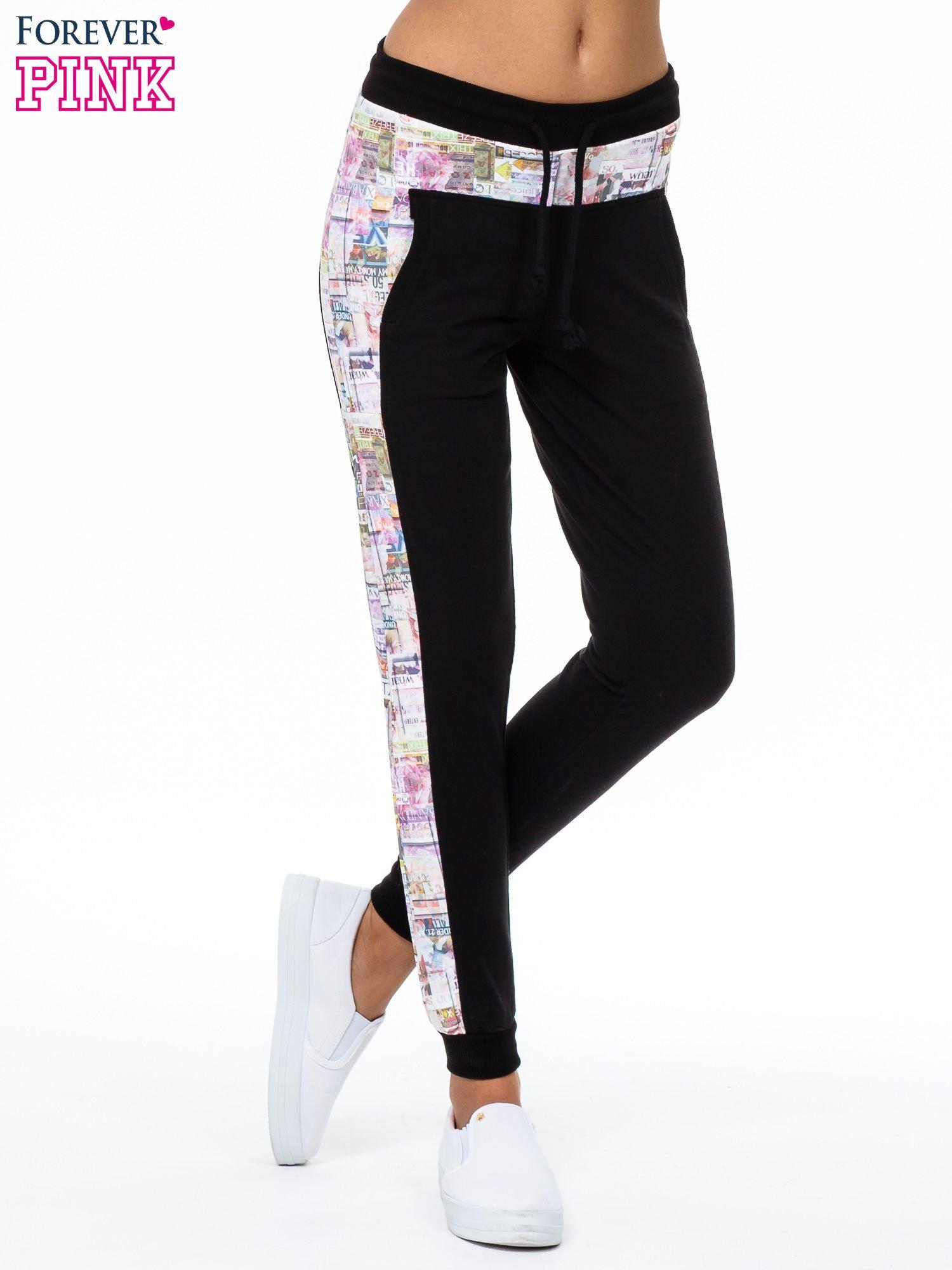 Czarne spodnie dresowe z gazetowym lampasem                                  zdj.                                  1