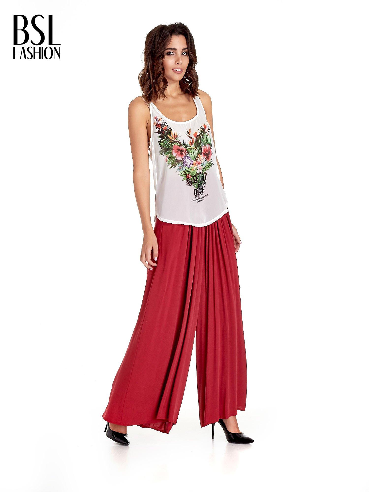 Czerwone zwiewne spodnie typu culottes                                  zdj.                                  4