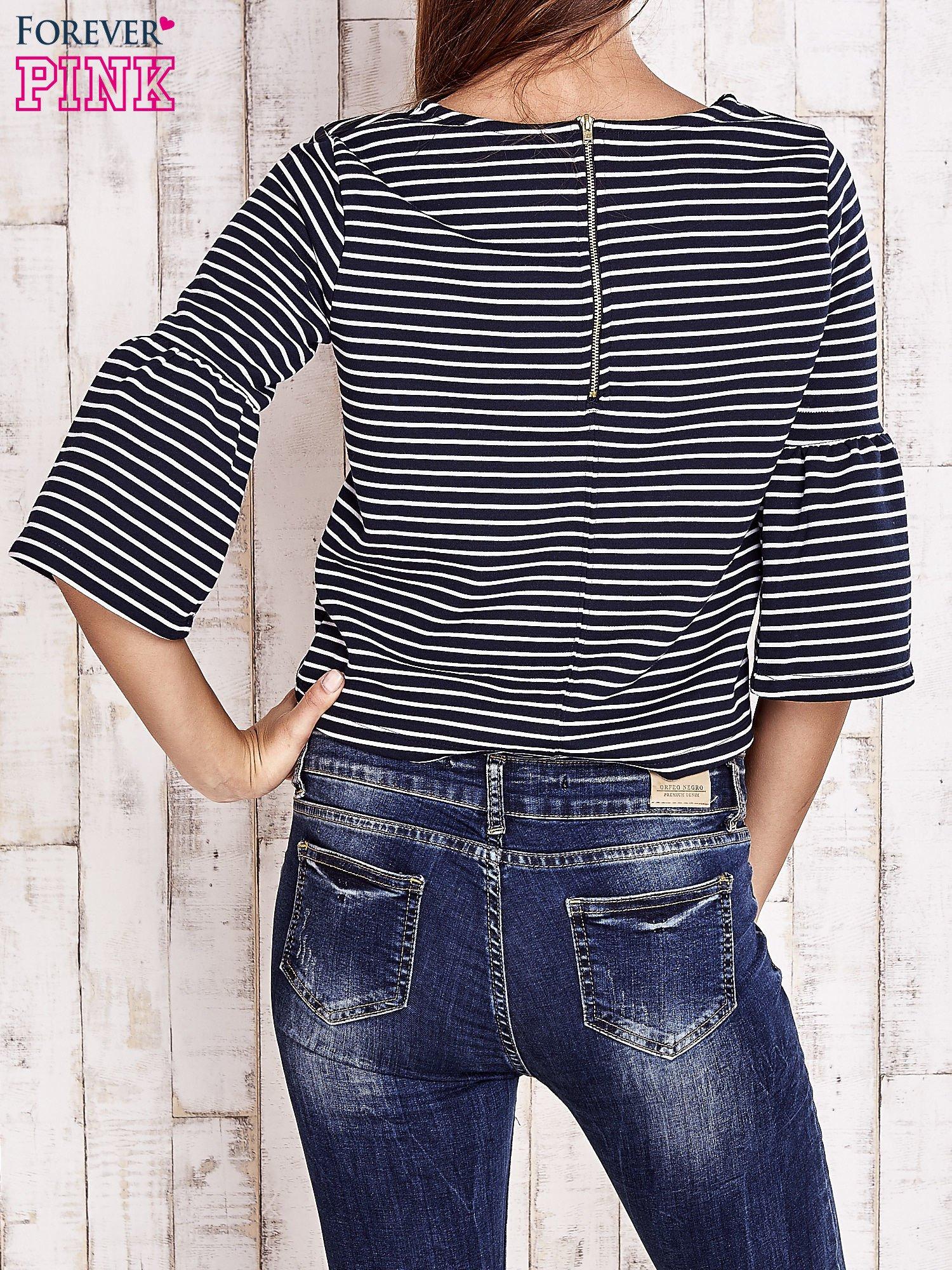 Granatowa bluzka w paski z suwakiem na plecach