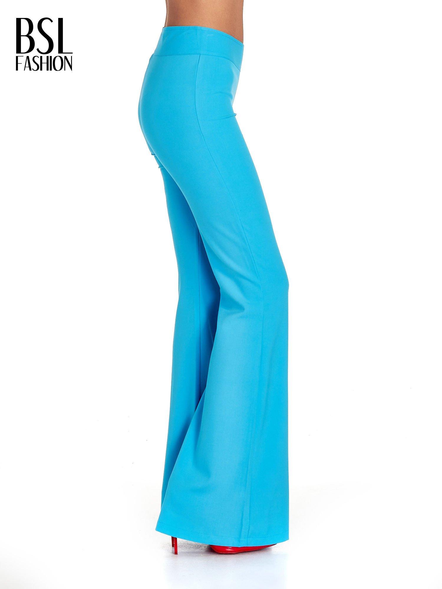 Jasnoniebieskie spodnie typu dzwony                                  zdj.                                  3