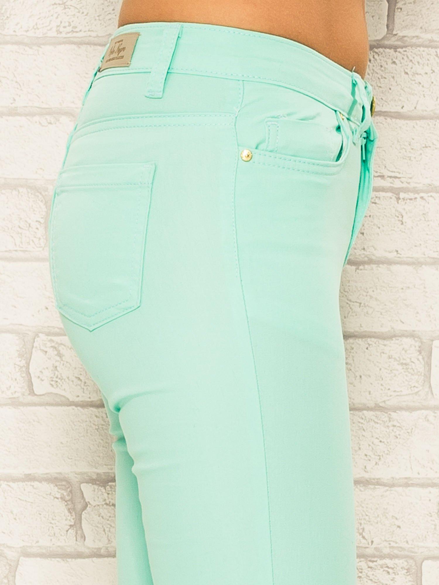 Miętowe spodnie rurki skinny z kieszeniami                                  zdj.                                  6