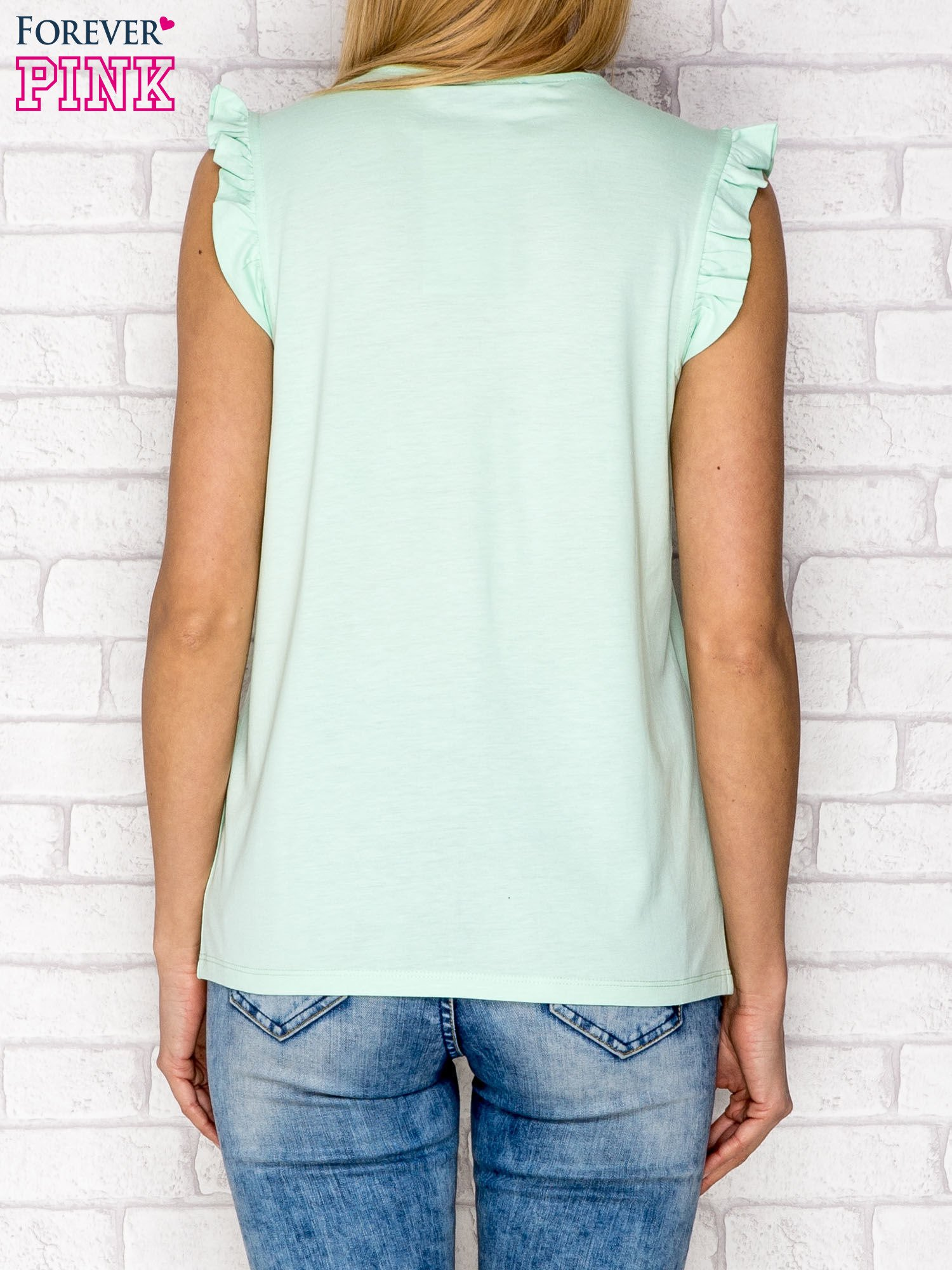 Miętowy t-shirt z koronką