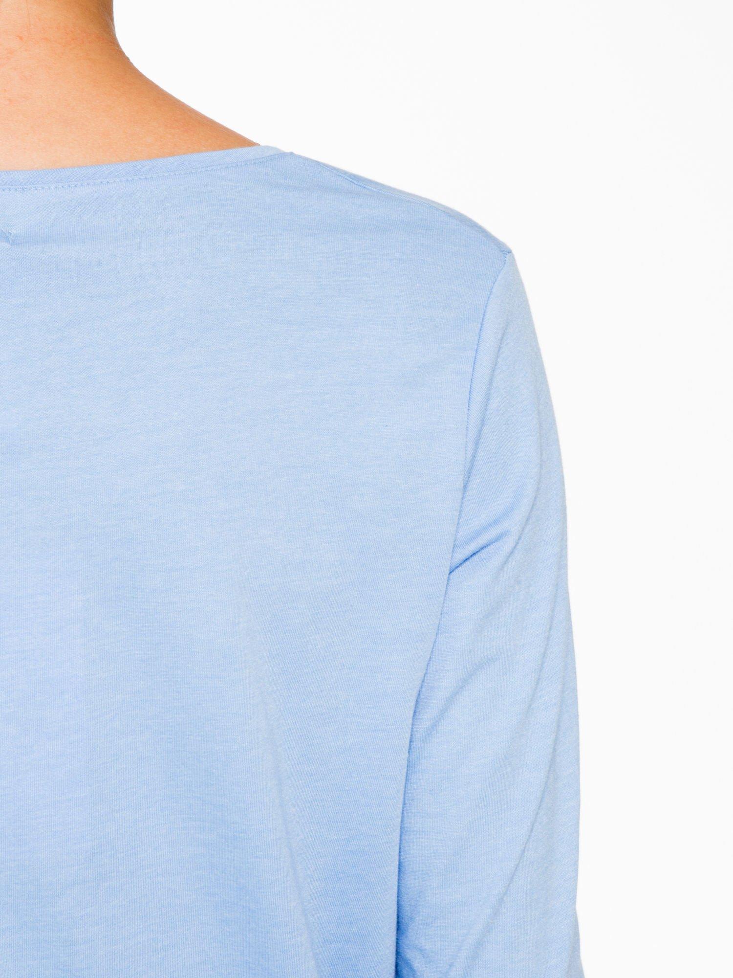 Niebieska bluzka o rozkloszowanym kroju z rękawem 3/4                                  zdj.                                  9