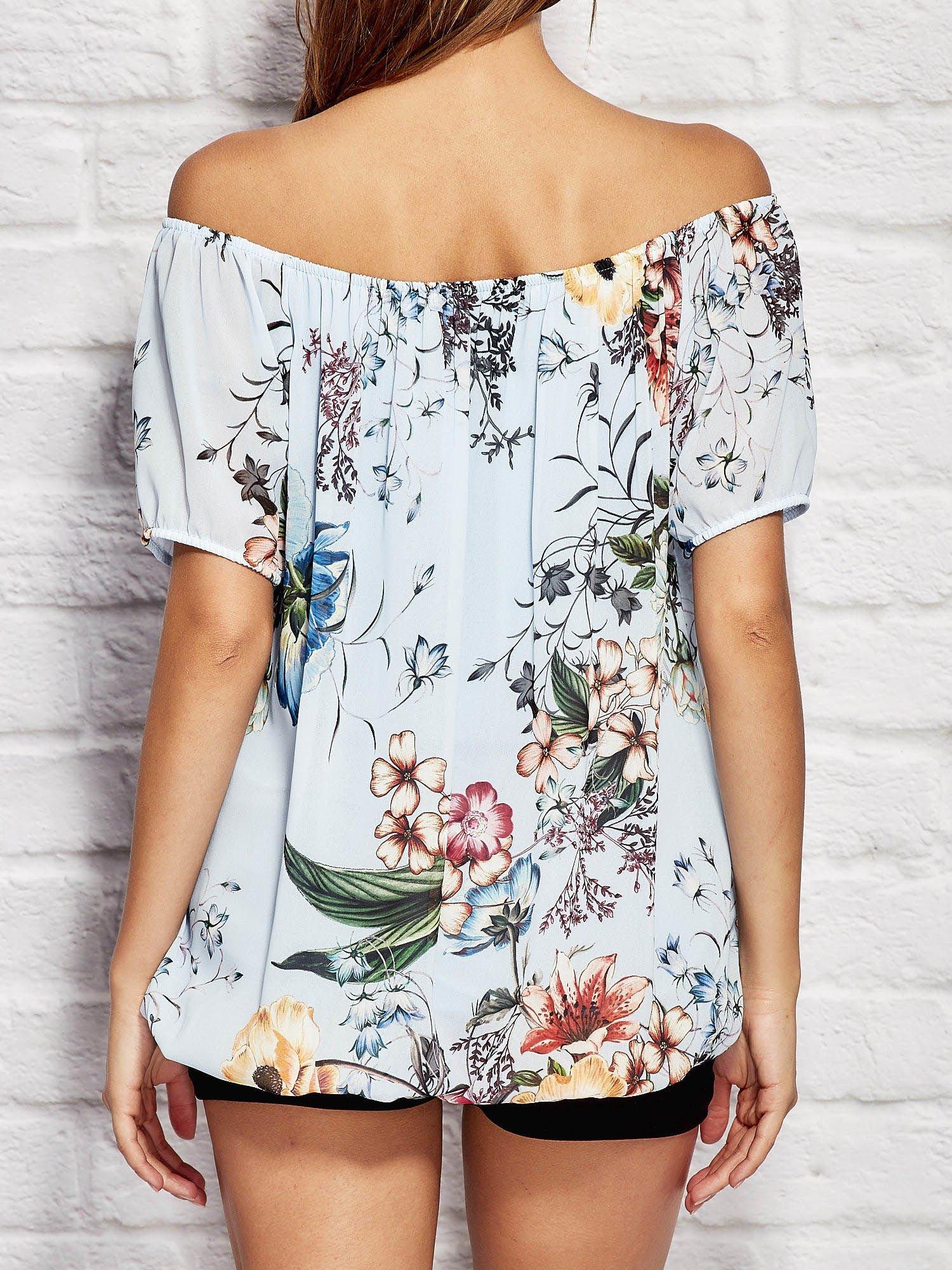 4f623711f371 Niebieska bluzka w kwiaty z wiązaniem przy dekolcie - Bluzka ...