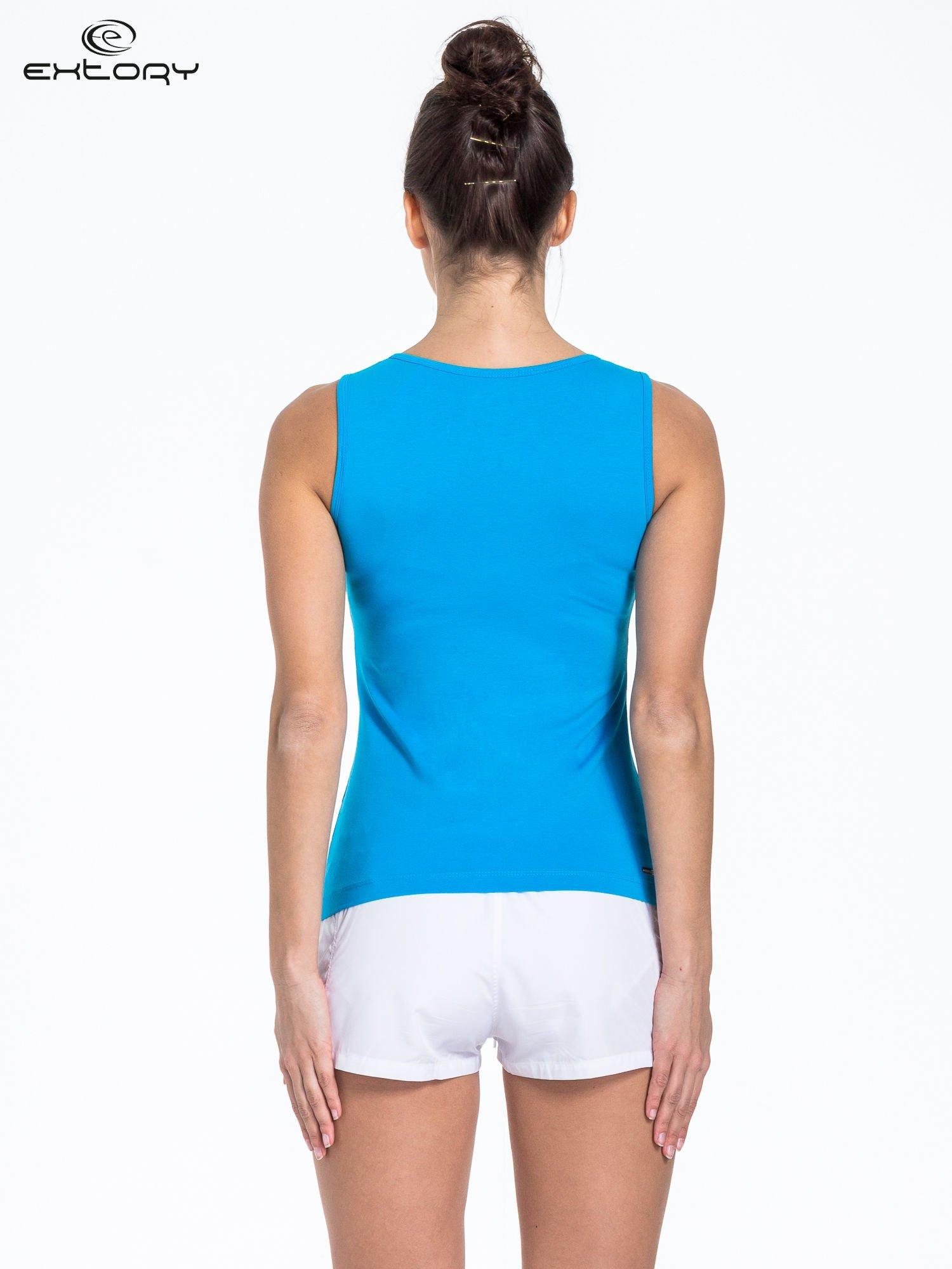 Niebieski top sportowy z białą wstawką                                  zdj.                                  3