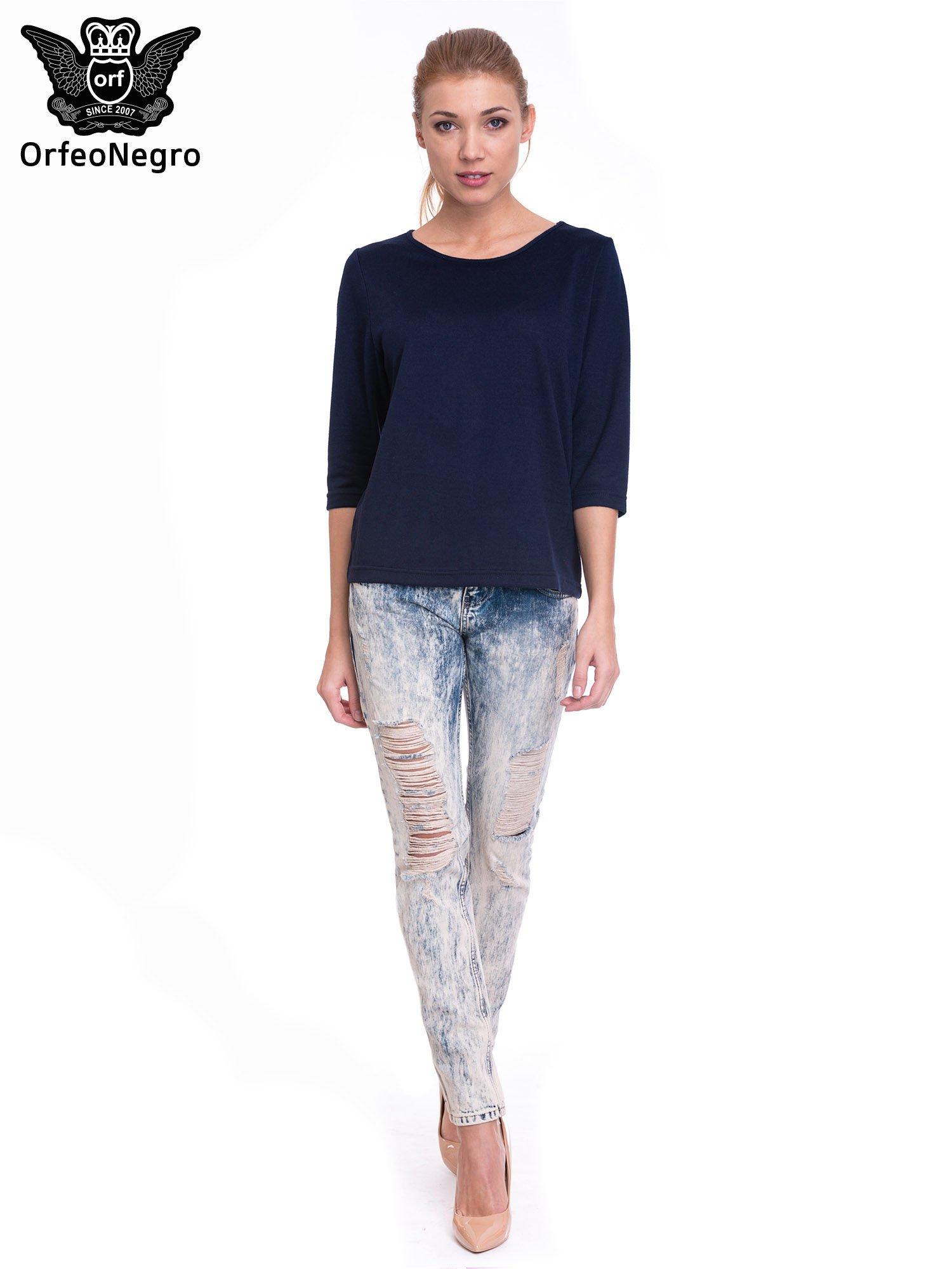 Niebieskie dekatyzowane spodnie trash jeans                                  zdj.                                  4