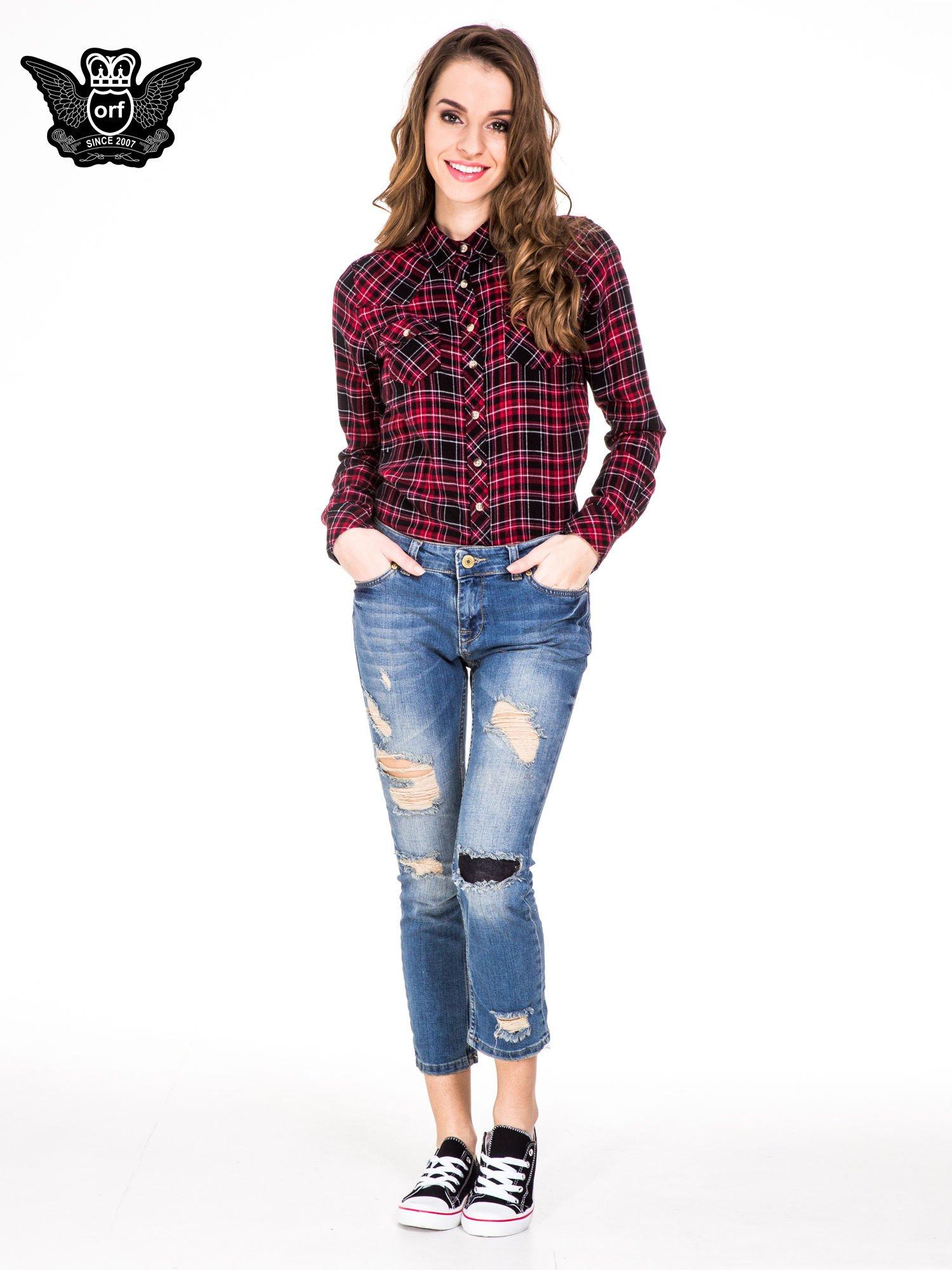 Niebieskie spodnie jeansowe rurki 7/8 z łatą i dziurami                                  zdj.                                  2