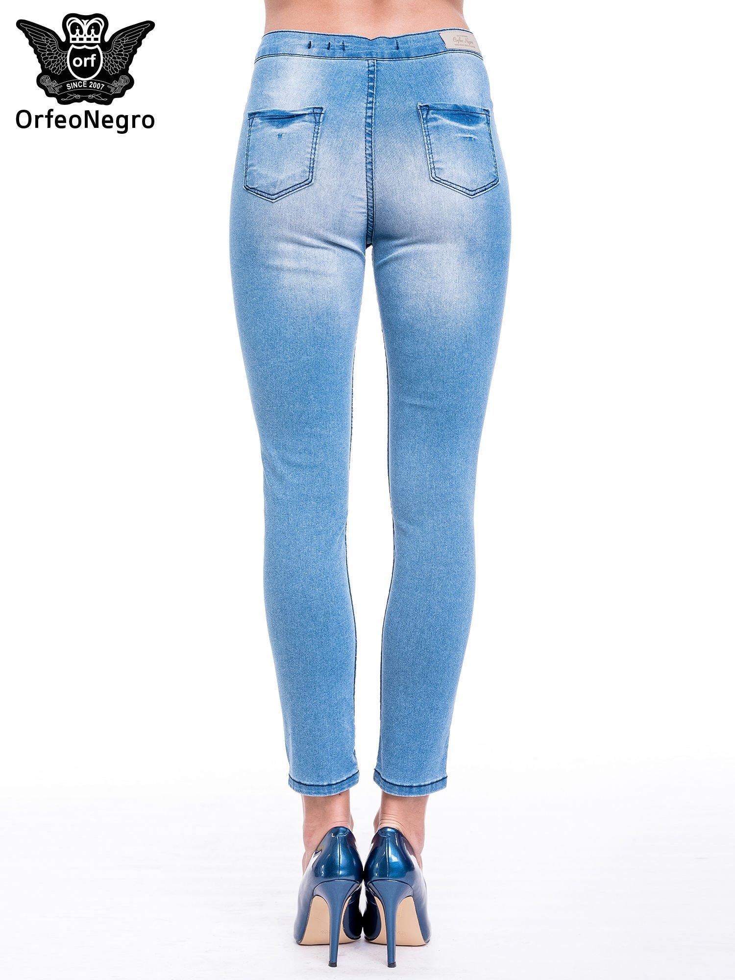 Niebieskie spodnie skinny jeans z wysokim stanem                                  zdj.                                  4