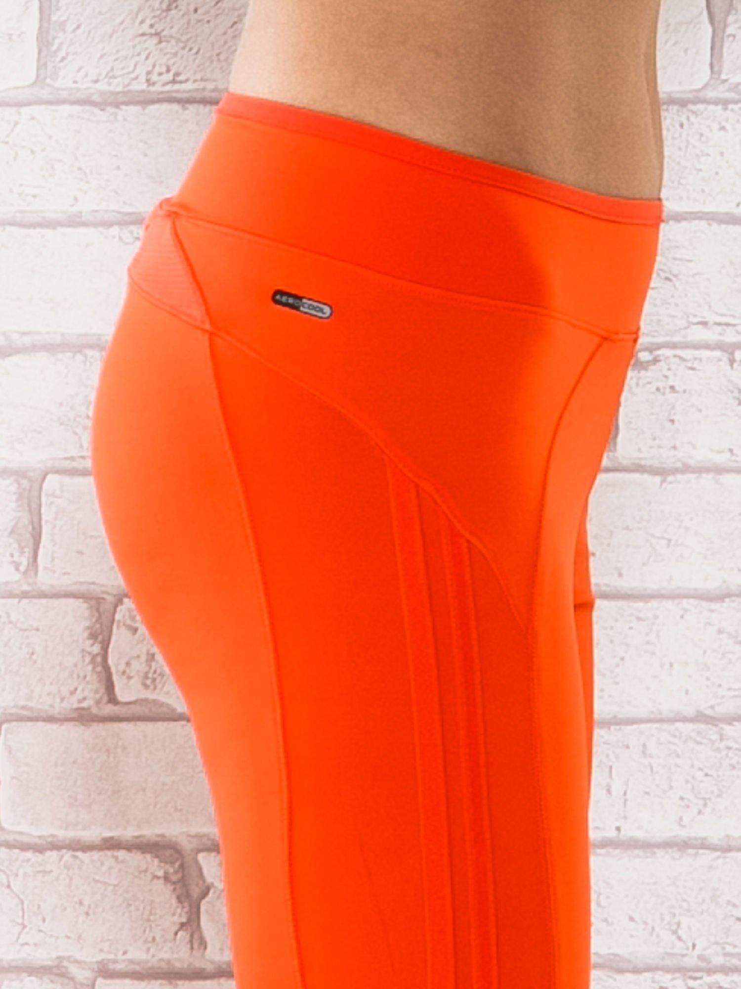 Pomarańczowe legginsy 3/4 sportowe termalne z lampasami                                  zdj.                                  5