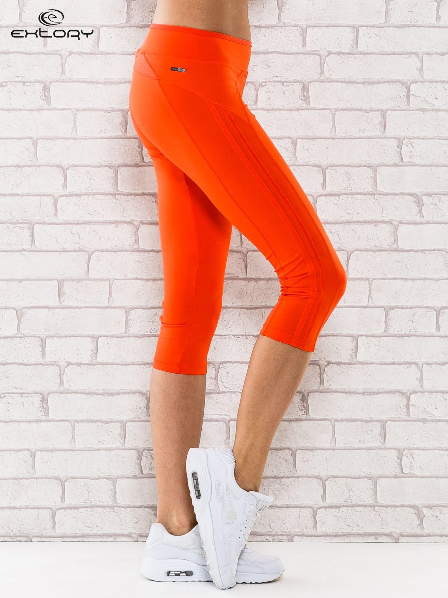 Pomarańczowe legginsy 3/4 sportowe termalne z lampasami                                  zdj.                                  3