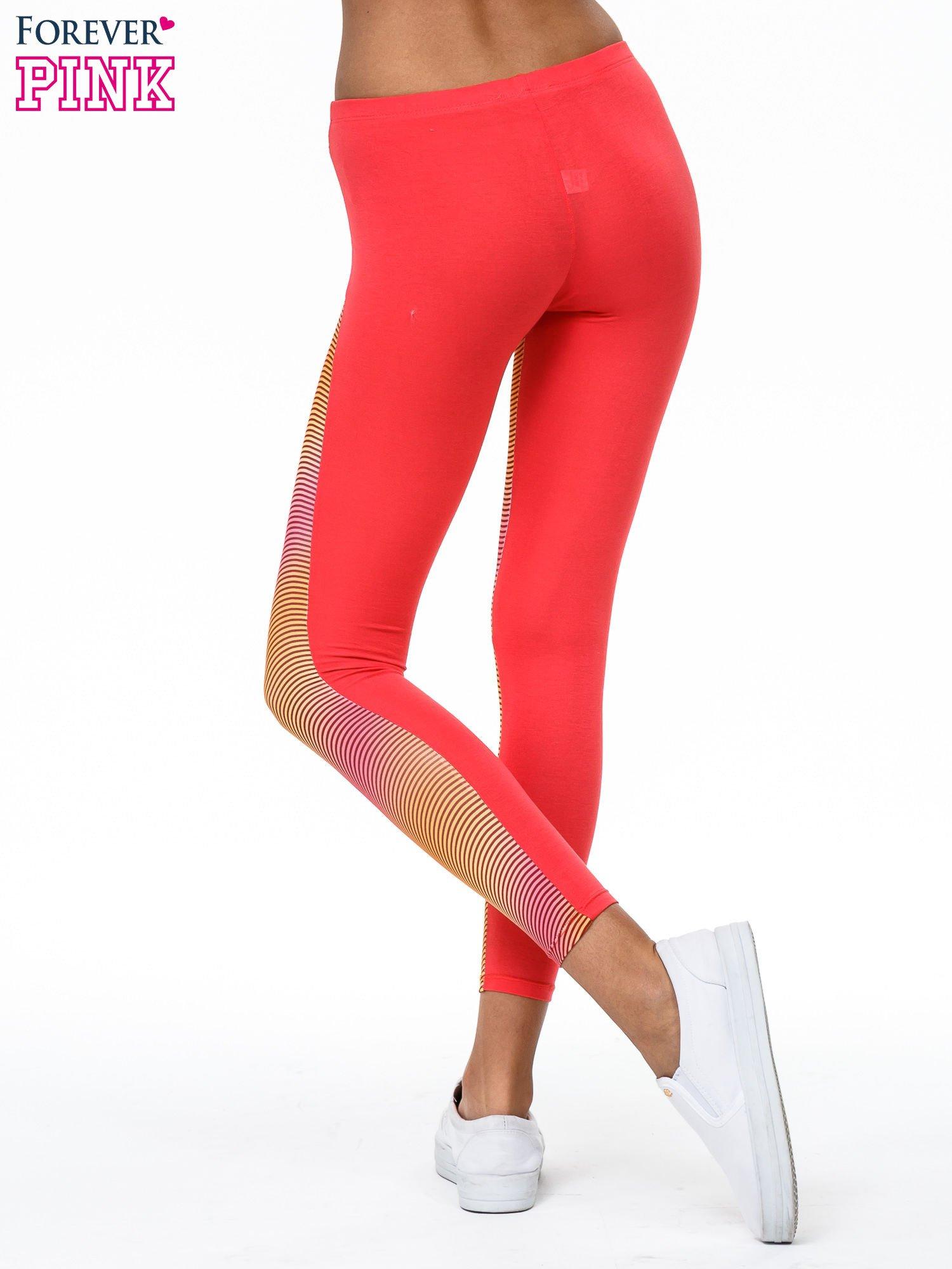 Pomarańczowe legginsy we fluorescencyjne wzory                                  zdj.                                  4