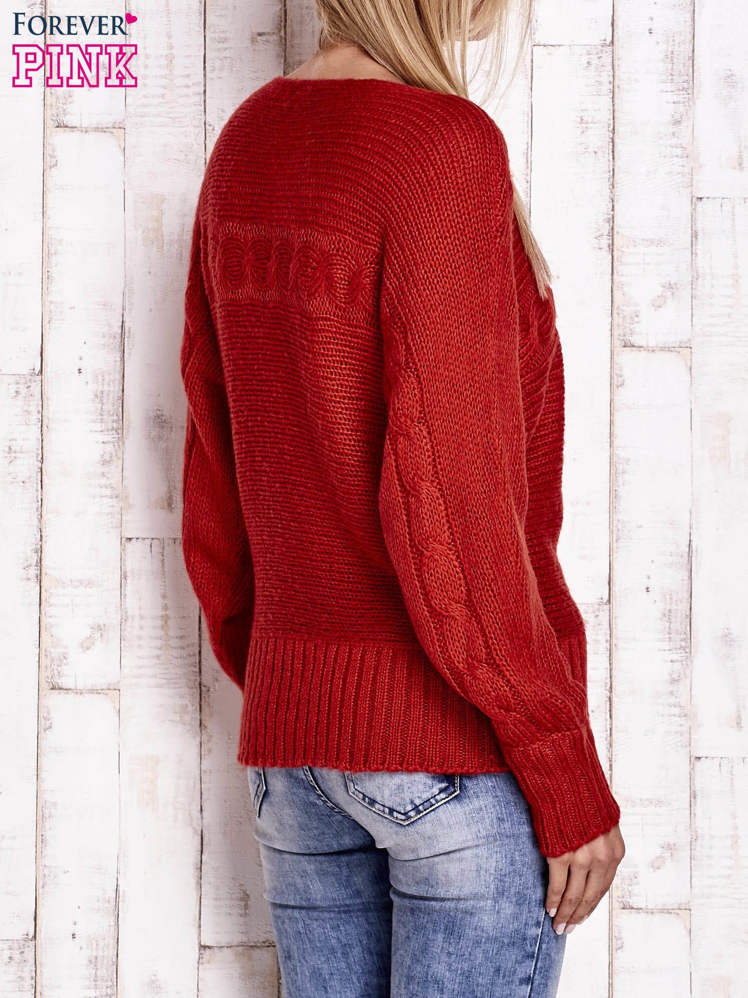 Pomarańczowy sweter z warkoczowym splotem                                  zdj.                                  2