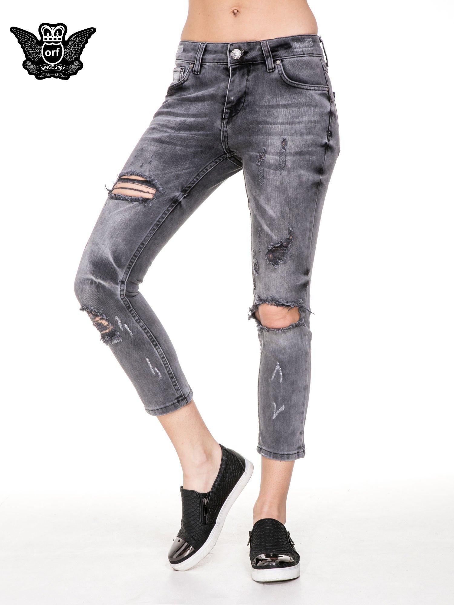 Szare rozjaśniane spodnie jeansowe 7/8 z rozdarciami                                  zdj.                                  1