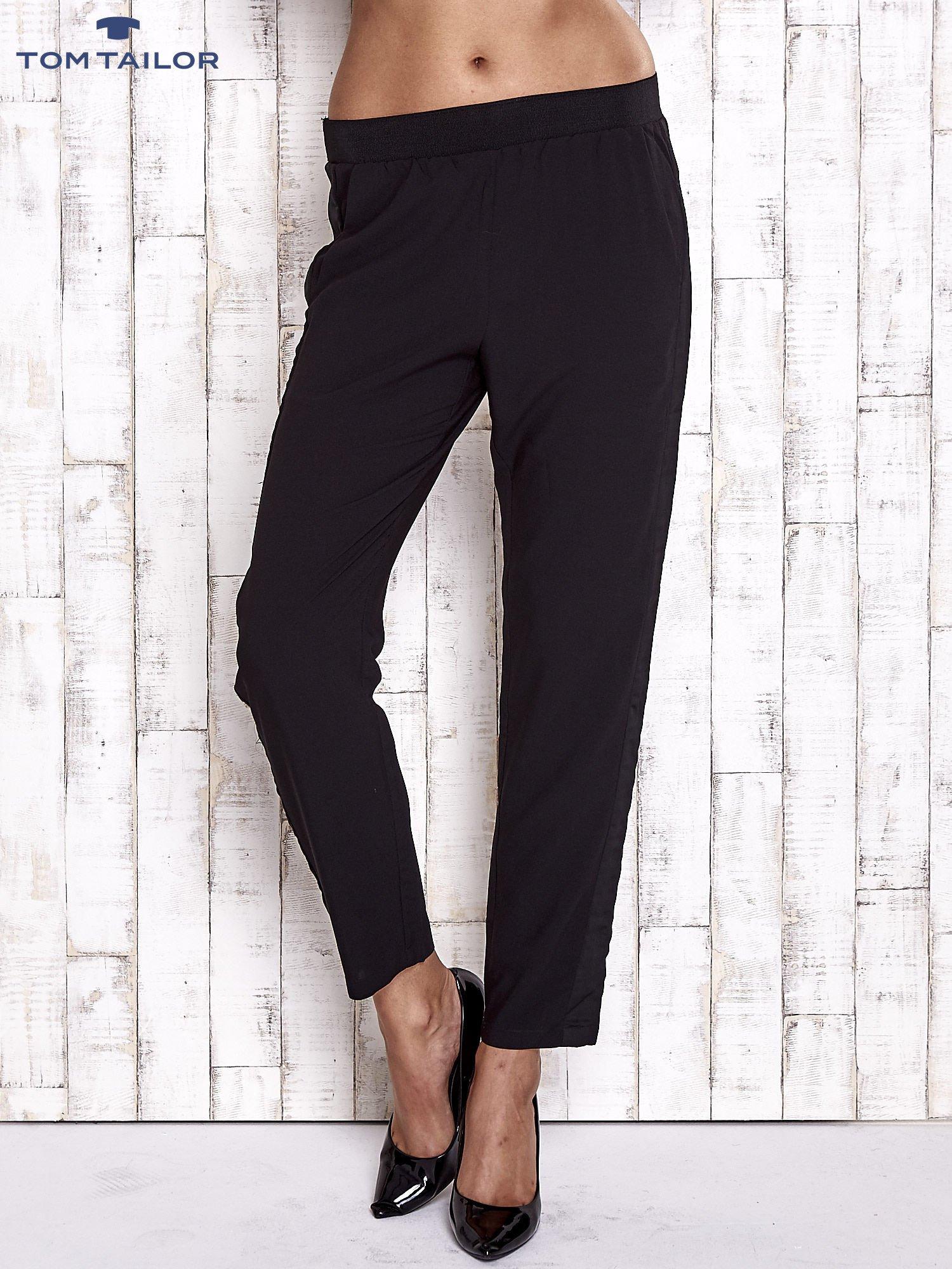 5f1e71e17056f TOM TAILOR Czarne lejące spodnie z lampasem - Spodnie z materiału ...