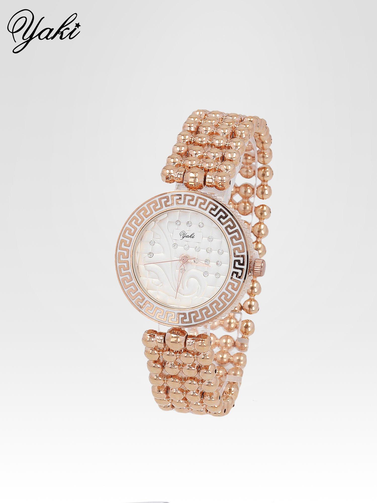 Złoty zegarek na bransolecie z grawerem wokół białej tarczy                                  zdj.                                  2