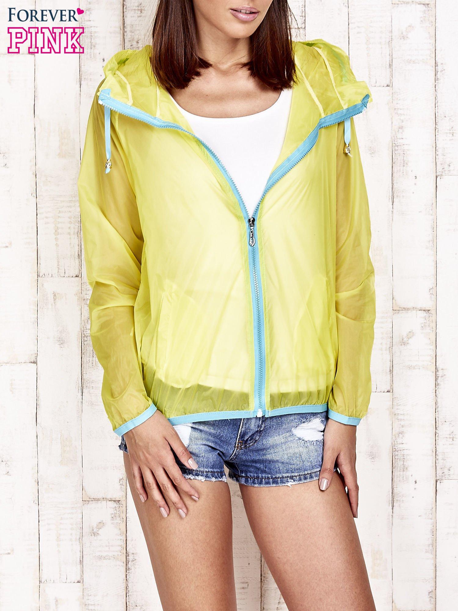 Żółta kurtka wiatrówka z niebieskim suwakiem                                  zdj.                                  1