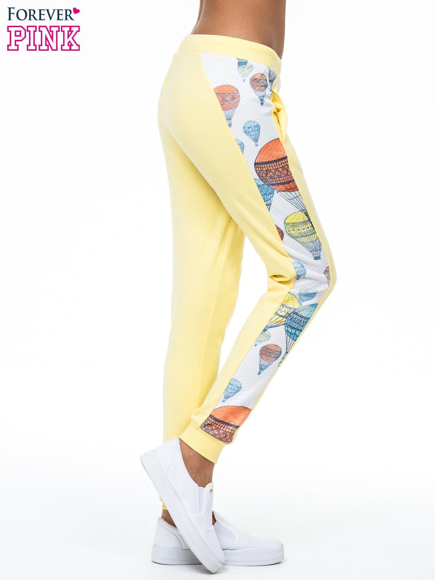 Żółte spodnie dresowe z lampasem w balony                                  zdj.                                  3