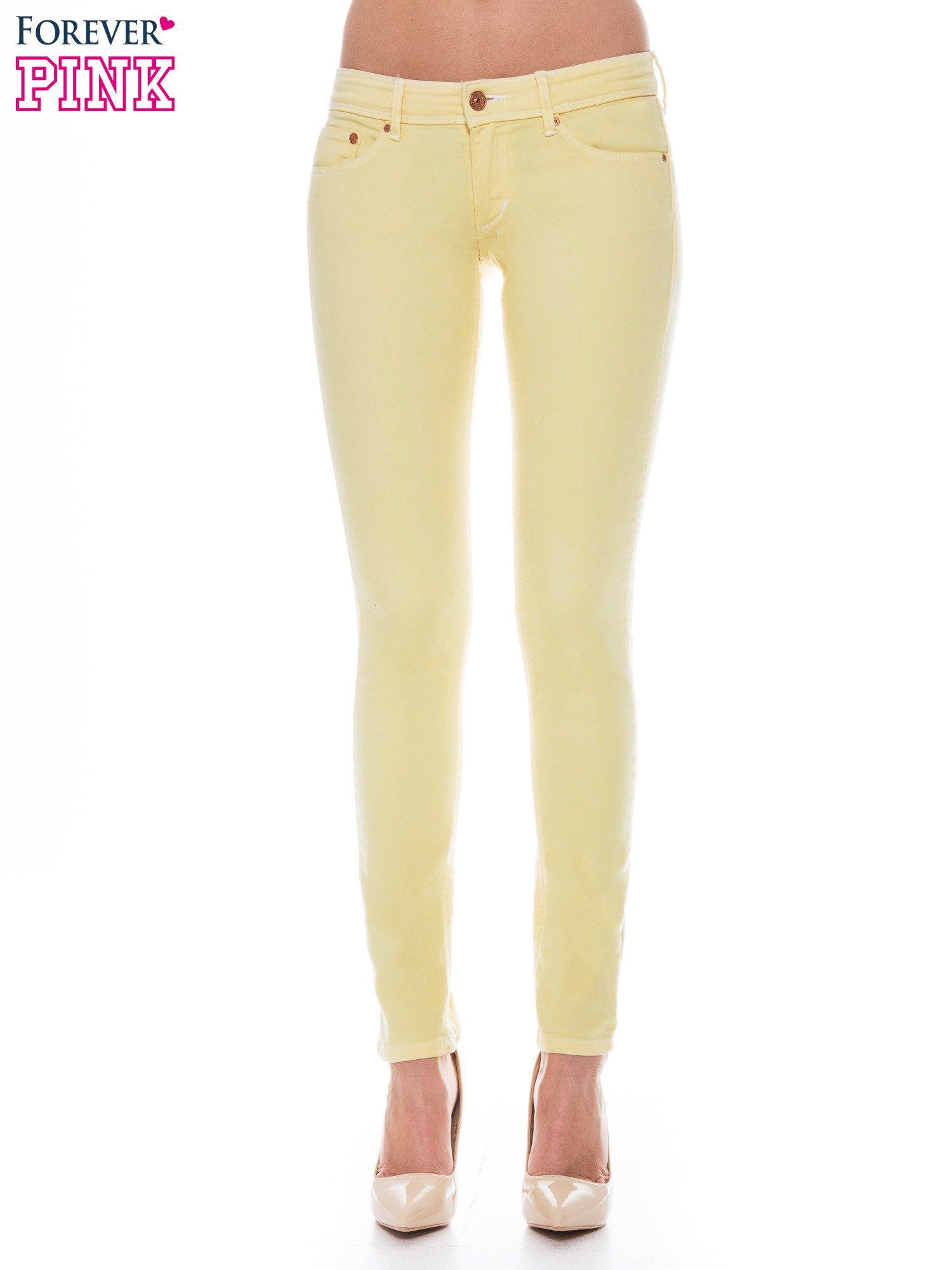 Żółte spodnie jeansowe typu rurki                                  zdj.                                  1