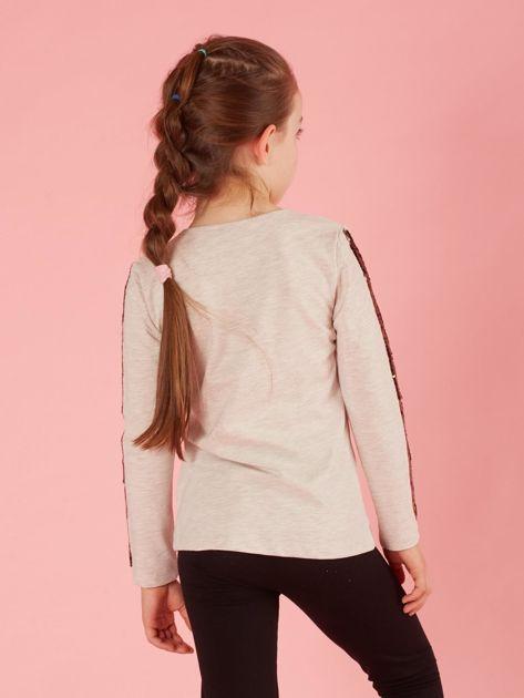 Beżowa bluzka dziecięca z cekinami                              zdj.                              2