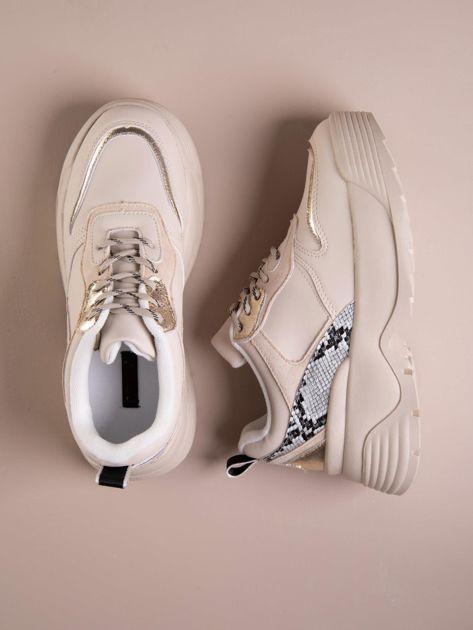 Beżowe buty sportowe na podwyższeniu z błyszczącą wstawką i zwierzęcym motywem                              zdj.                              1