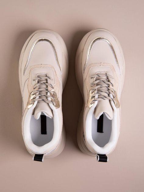 Beżowe buty sportowe na podwyższeniu z błyszczącą wstawką i zwierzęcym motywem                              zdj.                              4