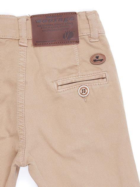 Beżowe materiałowe spodnie dla chłopca                               zdj.                              2