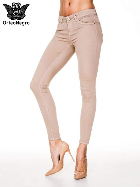 Beżowe spodnie typu skinny z elastycznego materiału                                  zdj.                                  1