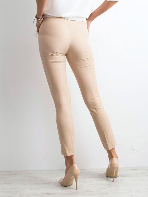 Beżowe spodnie z wiązaniem                              zdj.                              2