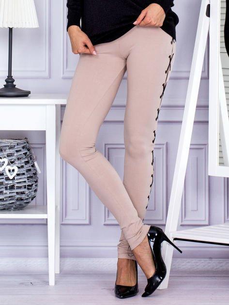 Beżowe sznurowane legginsy                               zdj.                              1