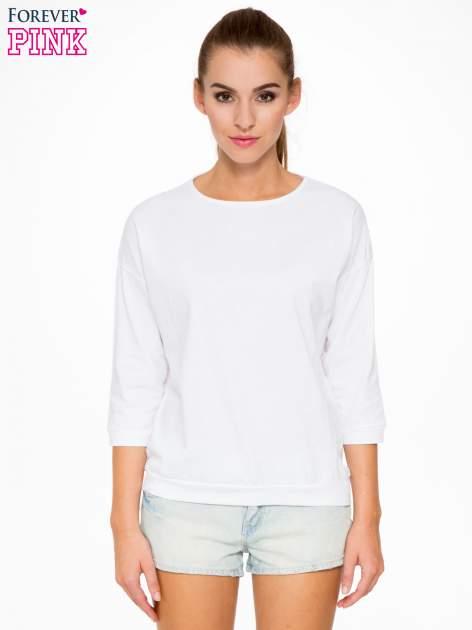 Biała bluzka z rękawem 3/4 i lekkim ściągaczem na dole