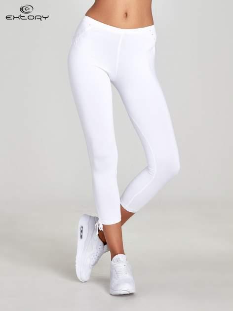 Białe legginsy sportowe termalne z dżetami i ściągaczem                                  zdj.                                  1
