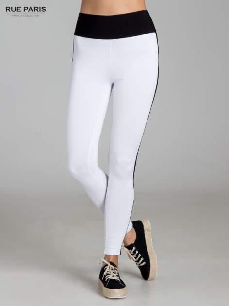 Białe legginsy ze skórzanymi lampasami po bokach                                  zdj.                                  1