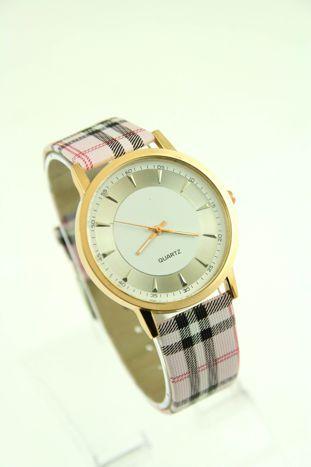 Biały zegarek damski na pasiastym pasku