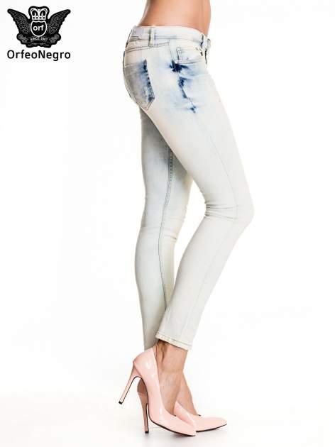 Błękitne rozjaśniane spodnie skinny jeans z przetarciami                                  zdj.                                  3