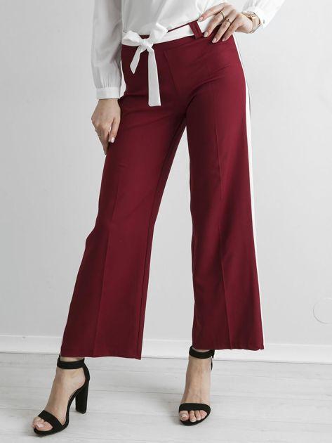 Bordowe szerokie spodnie z lampasami                              zdj.                              1