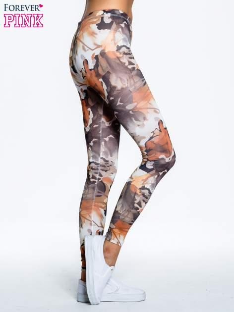 Brązowe legginsy w wielobarwne wzory                                  zdj.                                  3