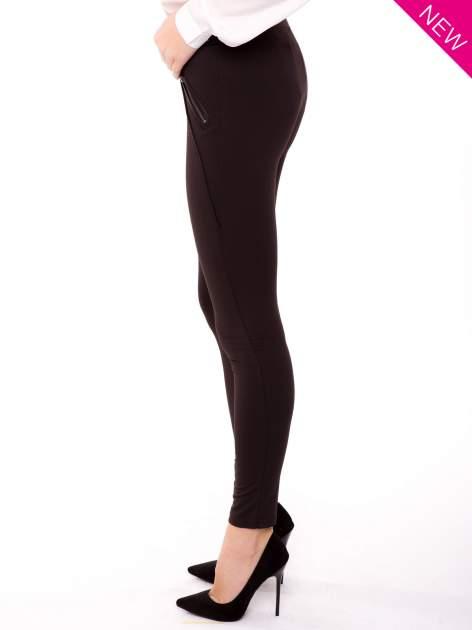 Brązowe legginsy z suwakami                                  zdj.                                  3