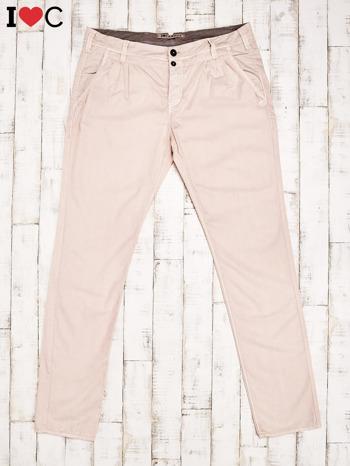 Brzoskwiniowe spodnie męskie                               zdj.                              1