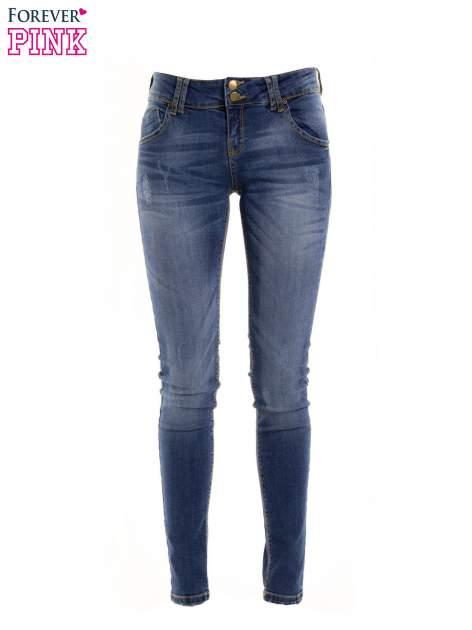Ciemnieniebieskie jeansy biodrówki na dwa guziki                                  zdj.                                  1