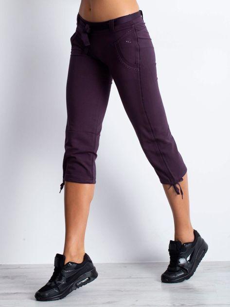 Ciemnofioletowe dresowe spodnie capri z materiałowym paskiem                                  zdj.                                  1